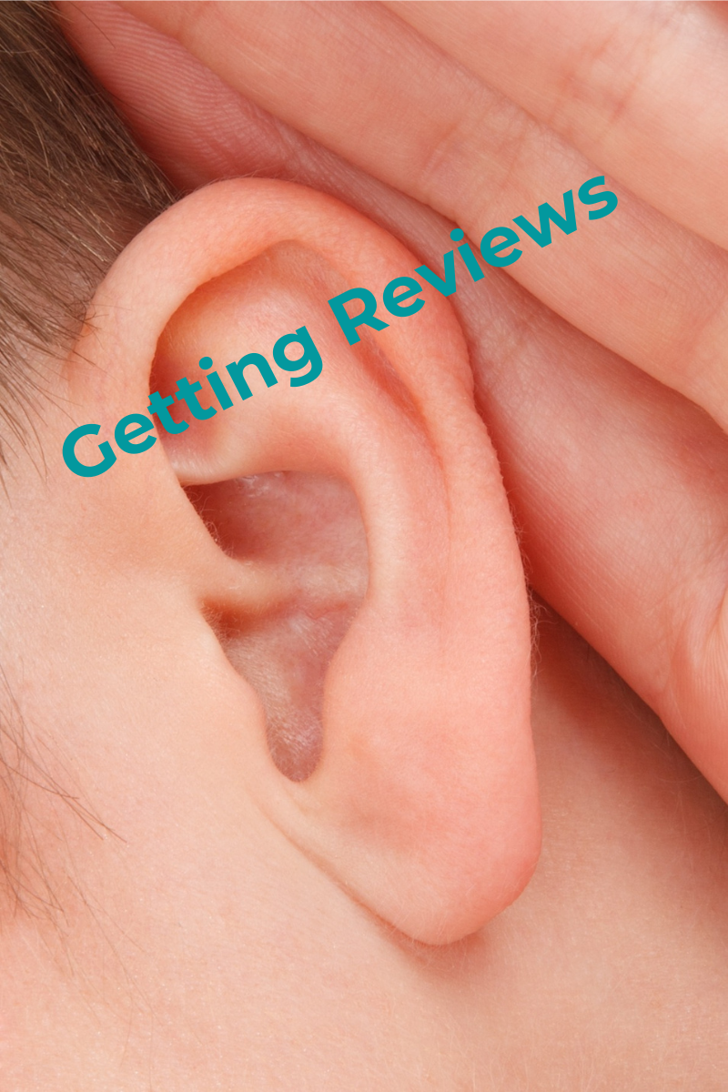 A image of an ear and and hand indicating hearing